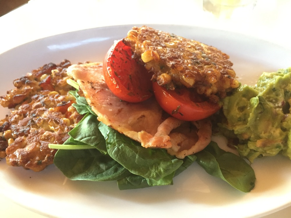 Sweetcorn fritters, roast tomato, spinach, bacon, and avocado salsa
