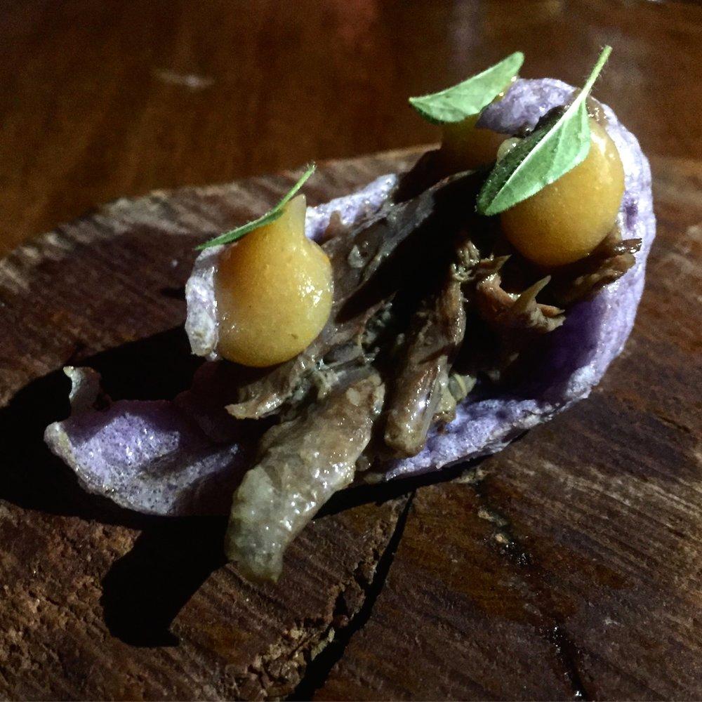 Confit titi (muttonbird) moe moe (maori potato) cracker,sweet and sour persimmon