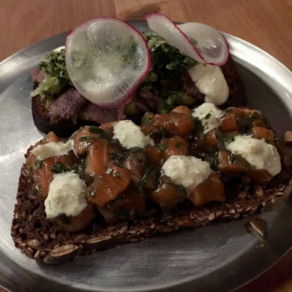 On Toast - salmon tartare, black truffle, kimchi aiolibeef tongue pastrami, horseradish cream, salsa verde