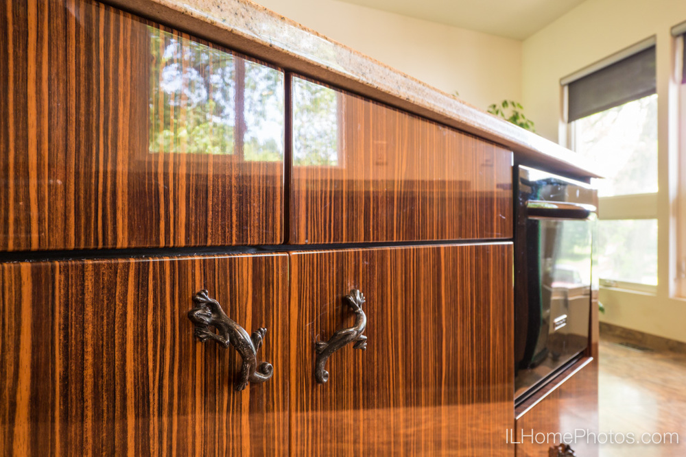Kitchen cabinet detail photograph (zebrawood with salamander door pulls), Delavan, IL :: Illinois Home Photography by Michael Gowin, Lincoln, IL