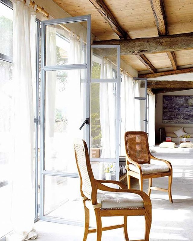 Open up the windows and doors and let the fresh breeze in! It's the First Day of Spring you guys!! 🌻 Loving these metal doors in this rustic villa. #TheDesignHunters #InteriorInspiration