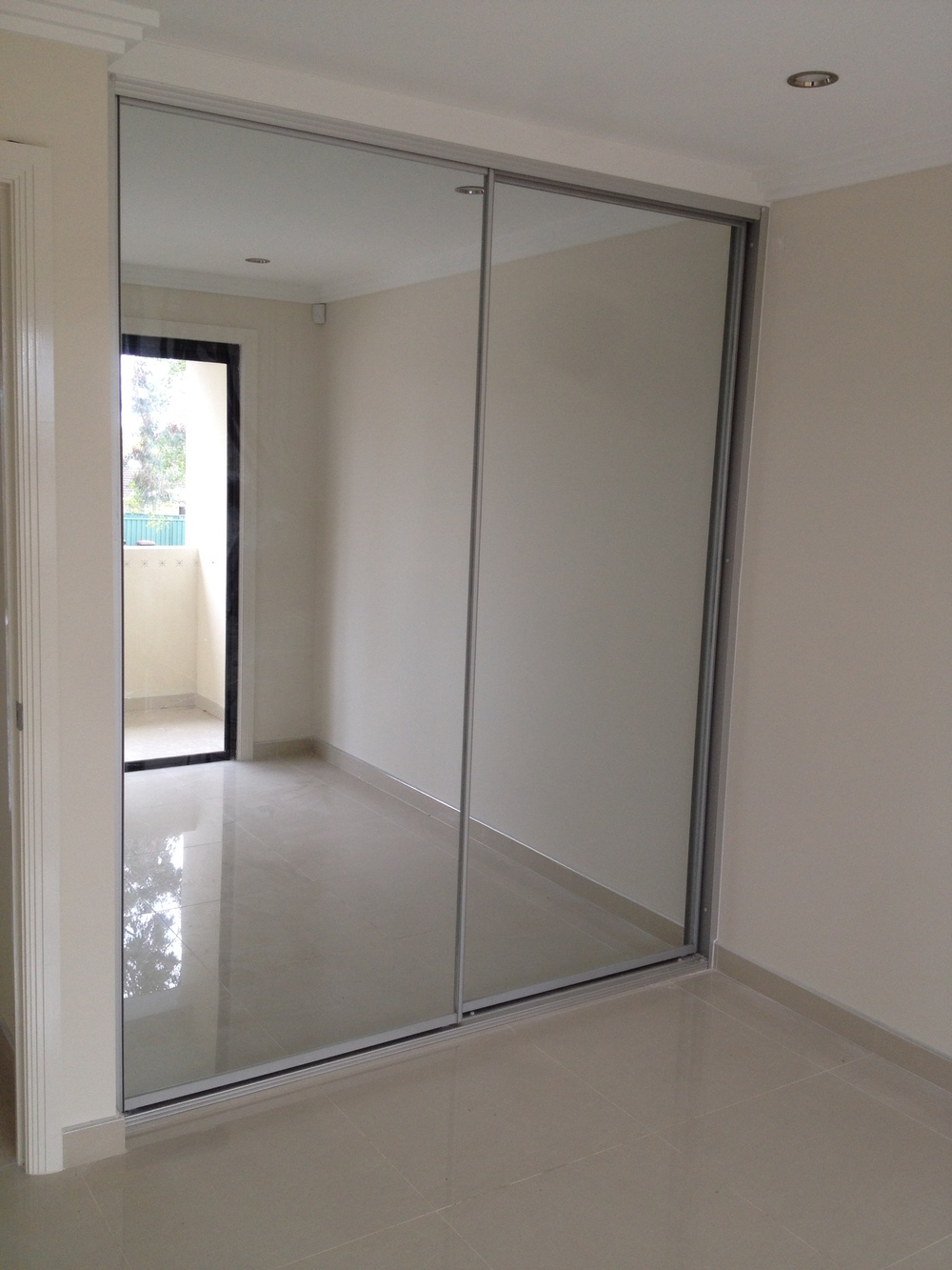 Contemporary sliding wardrobes quality kitchens and for Sliding mirror doors