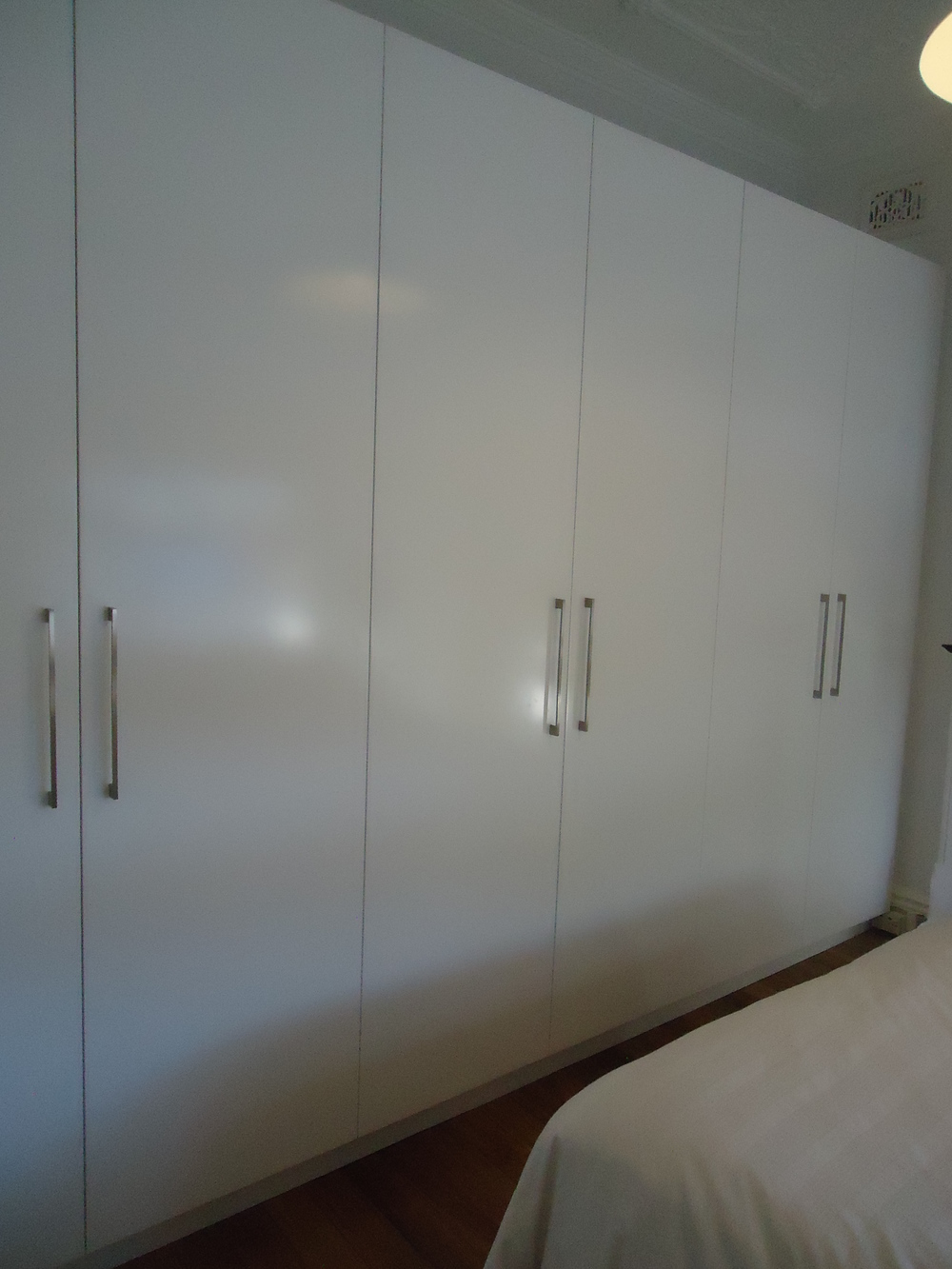 semi gloss hinged wardrobe with plain doors.JPG