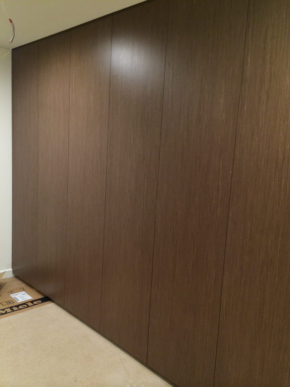 timber veneer hinged wardrobe with push to open.JPG