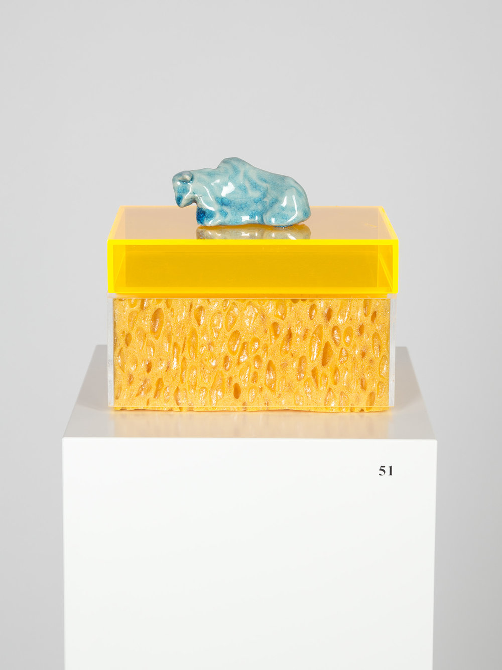 Gebettet , 2014  porcelain, sponge, plexiglas  Sculpture: 16 × 16 × 11 cm  Pedestal: 120 × 20 × 20 cm