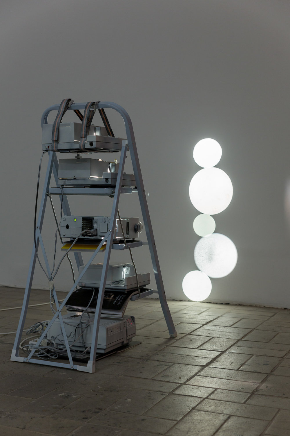 Fünf Monde , 2015  5 slide projectors and household ladder  102 × 45 × 75 cm