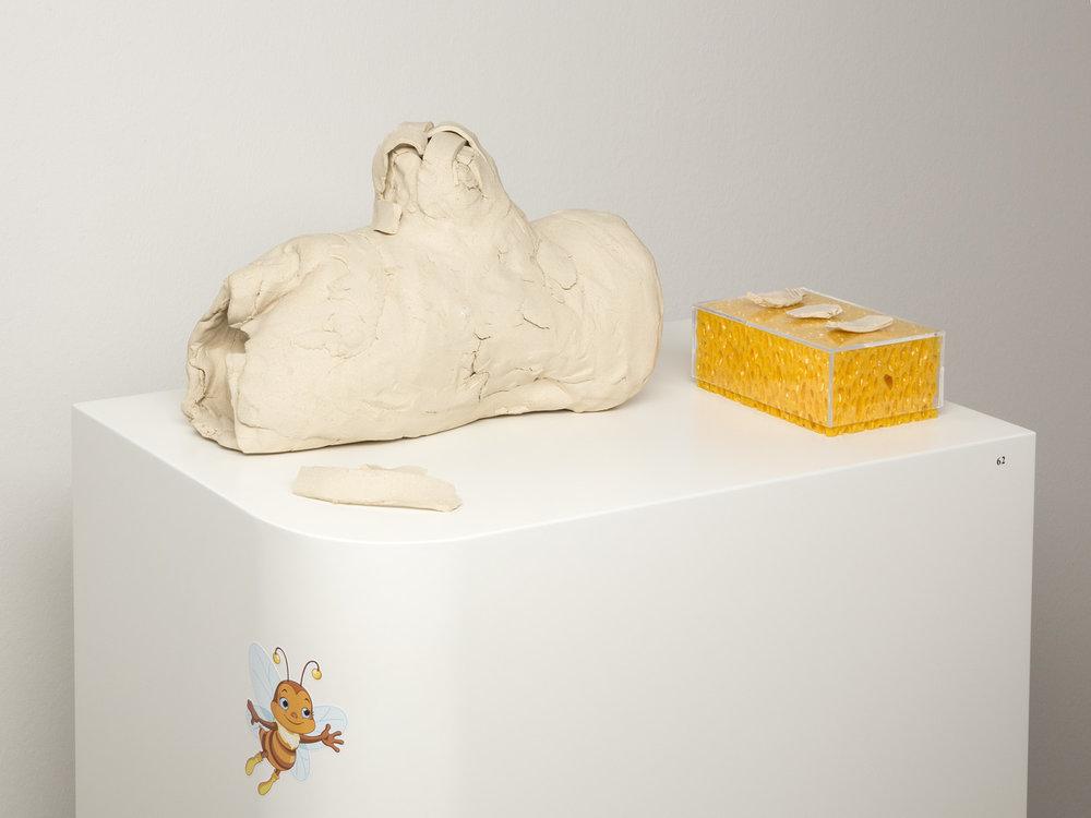 Bienengarten , 2012  Clay, sponge, plexiglas, sticker  23 × 50 × 30 cm (9 × 19 ⅝ × 11 ¾ inches)  Pedestal: 90 × 60 × 40 cm