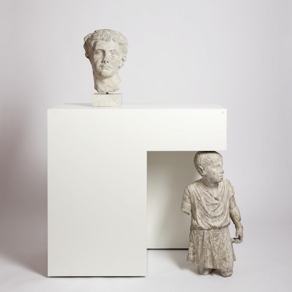 Prinz und Sklave , 2014  plaster and painted MDF, pedestal  130 × 100 × 50 cm