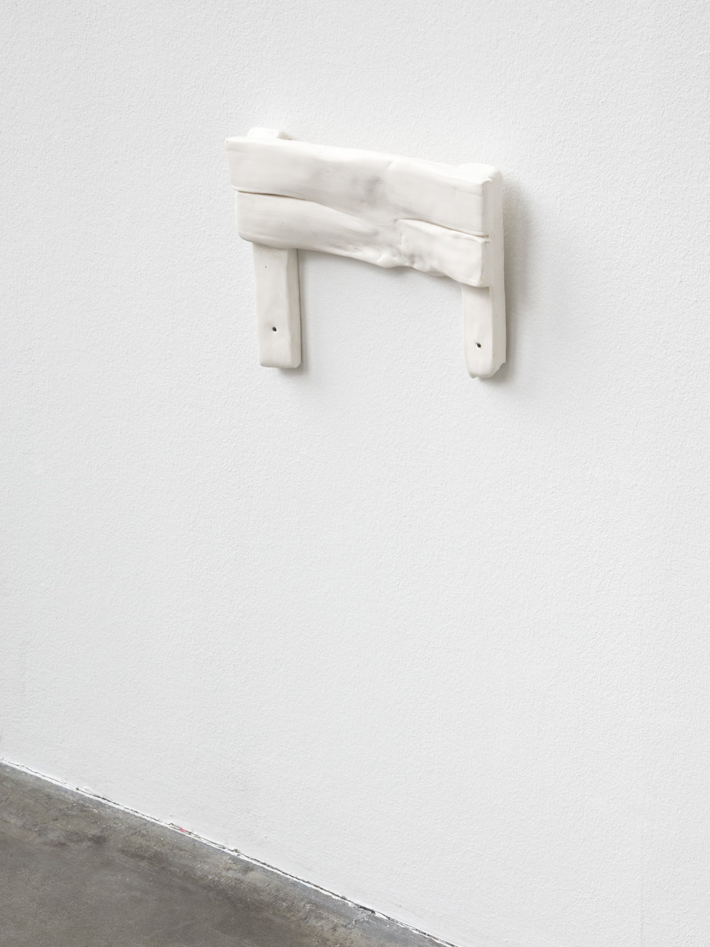 Abrutschen , 2014  porcelain and nails  23 × 32 × 6 cm