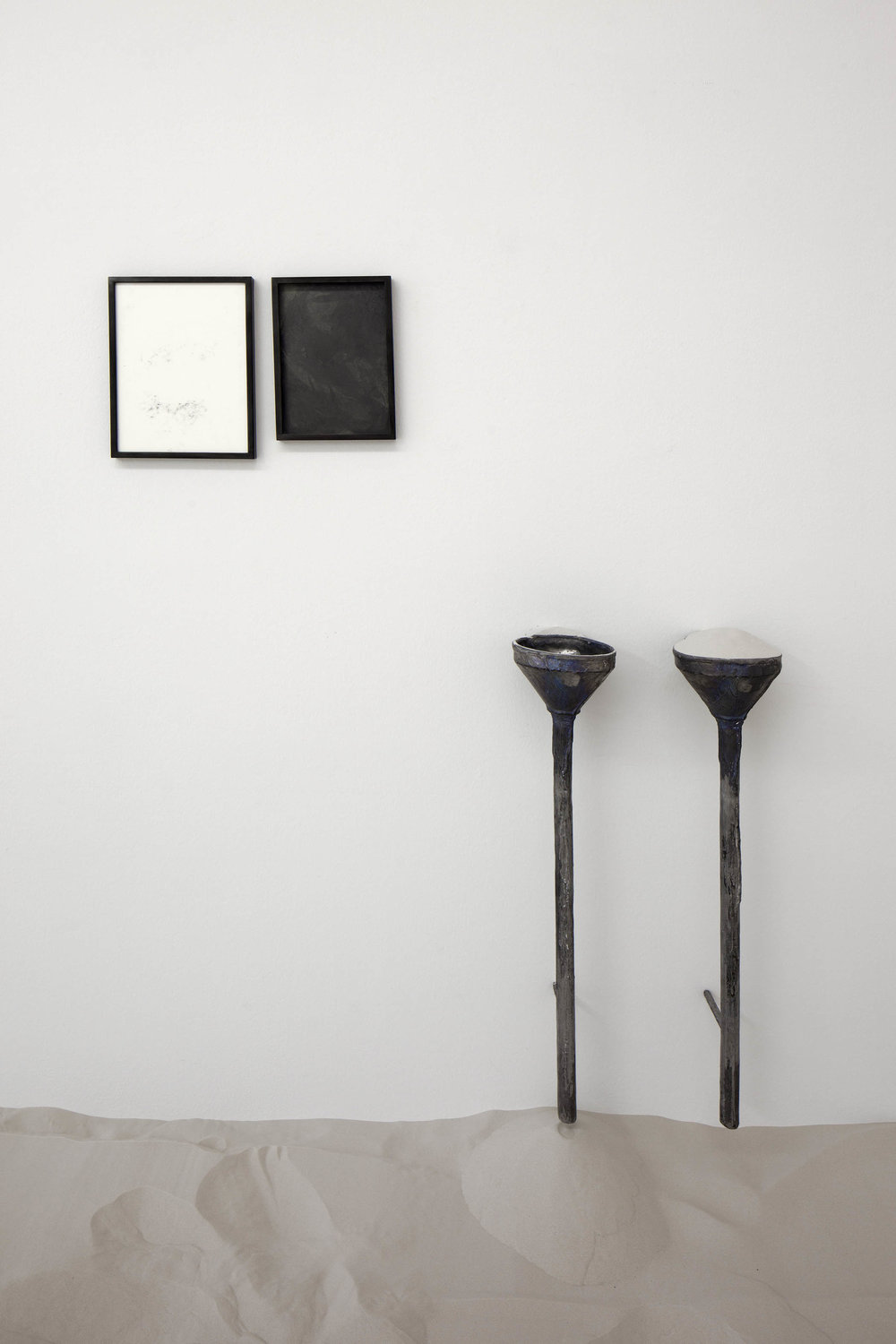 PENDING , 2015  lead, sand, graphite, spit, lacquer  Part 1:  31,5 × 23,5 cm (12 ⅜ × 9 ¼ inches)  33,5 × 25,5 × 2,5 cm (13 ¼ × 10 × 1 inches) (framed)  Part 2:  28 × 18,6 cm   30 × 20,6 × 2,5 cm (framed)  Part 3 & 4: 80 × 17 × 13,5 cm