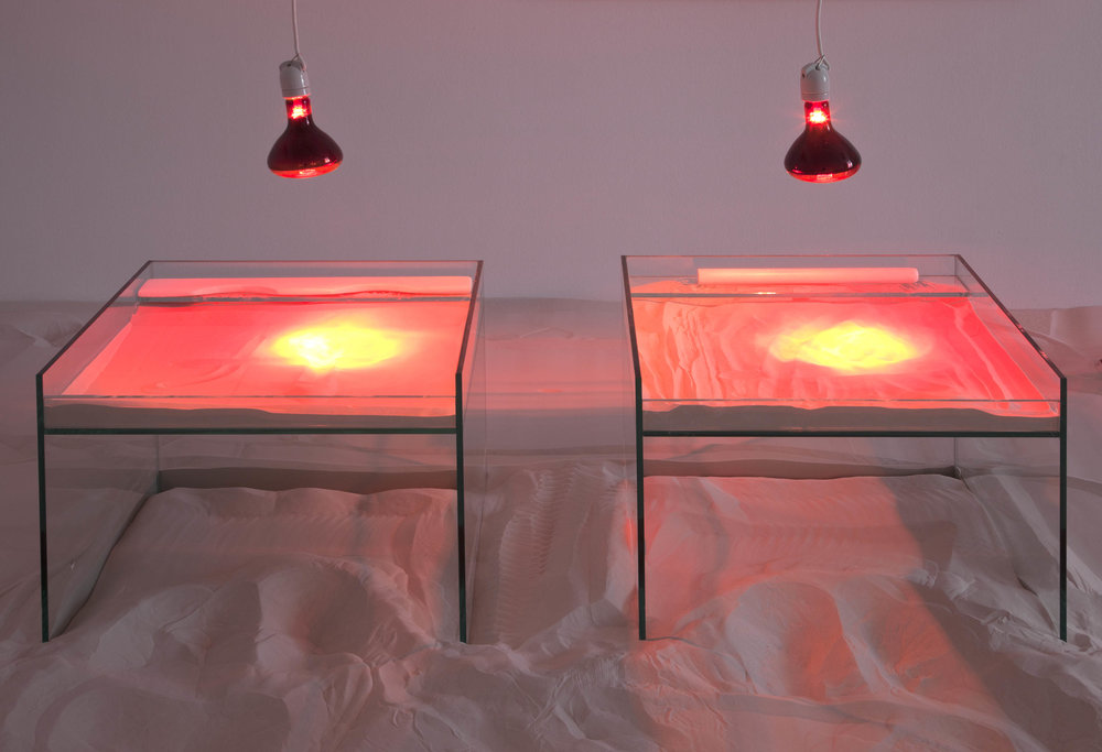 Übung , 2015  glass, sand, heat lamp and wood  Dimensions variable  Unique