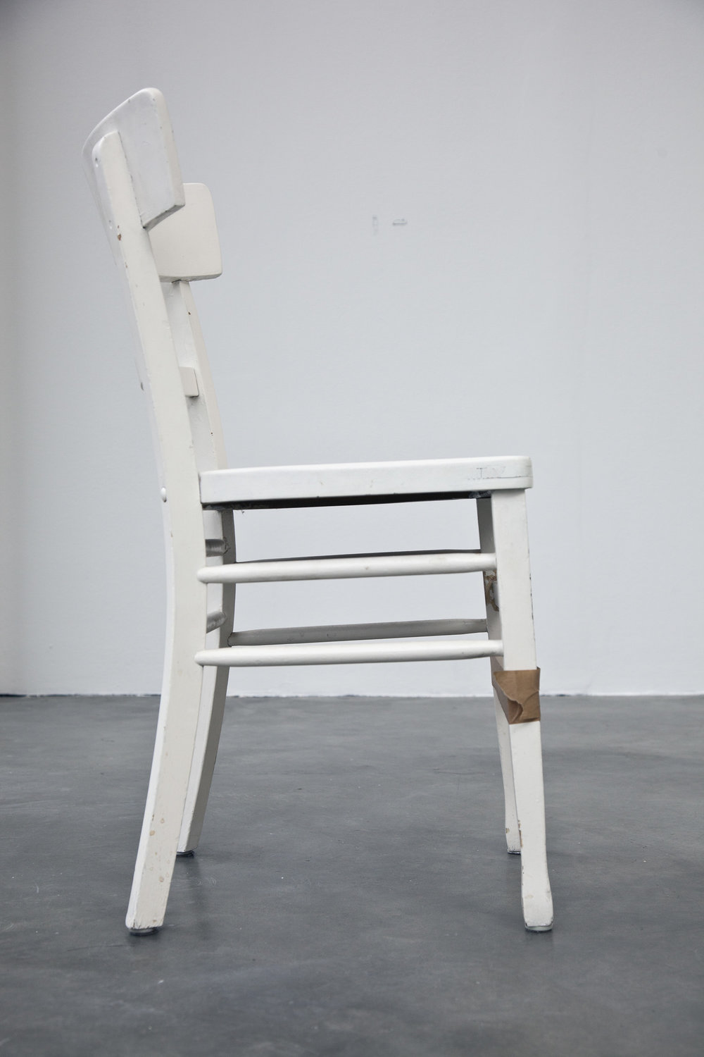 Kläglicher Rest eines performativen Vorgangs , 2013  chair (from the artist's kitchen) and tape