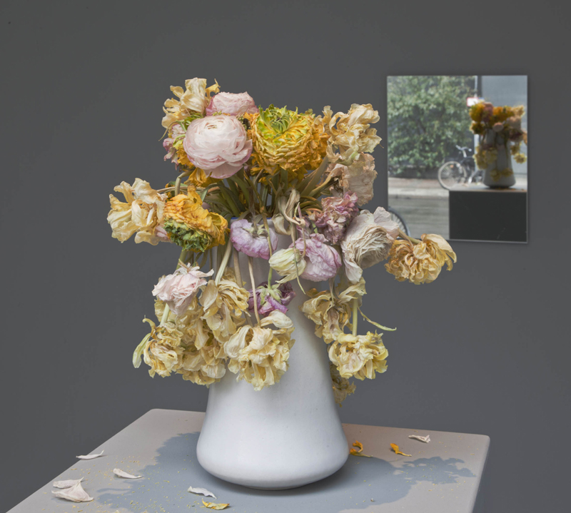 Beziehungen (Relationships) , 2013, 3 part work  ceramic vase, pedestal, mirror, and an annual, lifetime delivery of a bouquet of flowers  vase + bouquet of flowers: 41 × 13 × 13 cm (16 ⅛ × 5 ⅛ × 5 ⅛ inches)  mirror: 47 × 36 cm