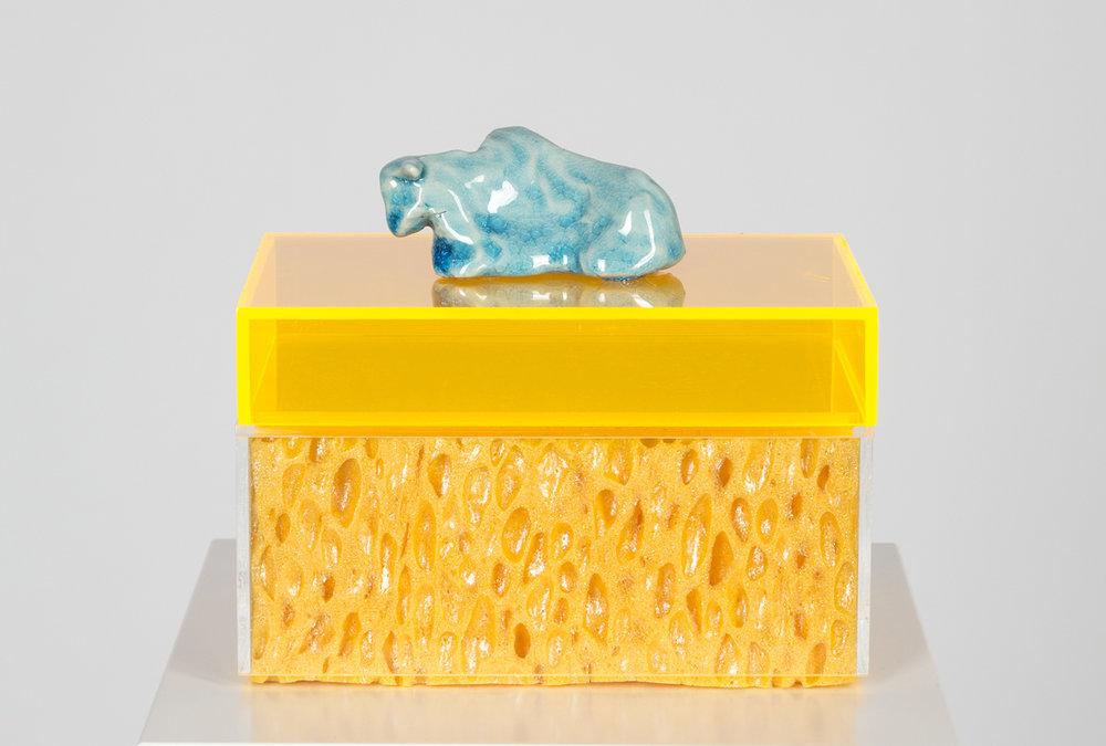 Gebettet , 2014  porcelain, sponge, plexiglas  Sculpture:16 × 16 × 11 cm  Pedestal:120 × 20 × 20 cm