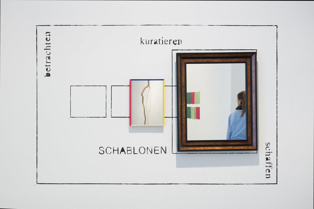 Schablone (kleines Ich; Großes Ich) , 2008/2013, 2 part work  wall painting, wood frame and crystal mirror  part 1: Großes Ich (Über-Ich): 76,2 × 66,1 cm (30 × 26 inches)  part 2: Kleines Ich (Ich): 37 × 27,9 cm