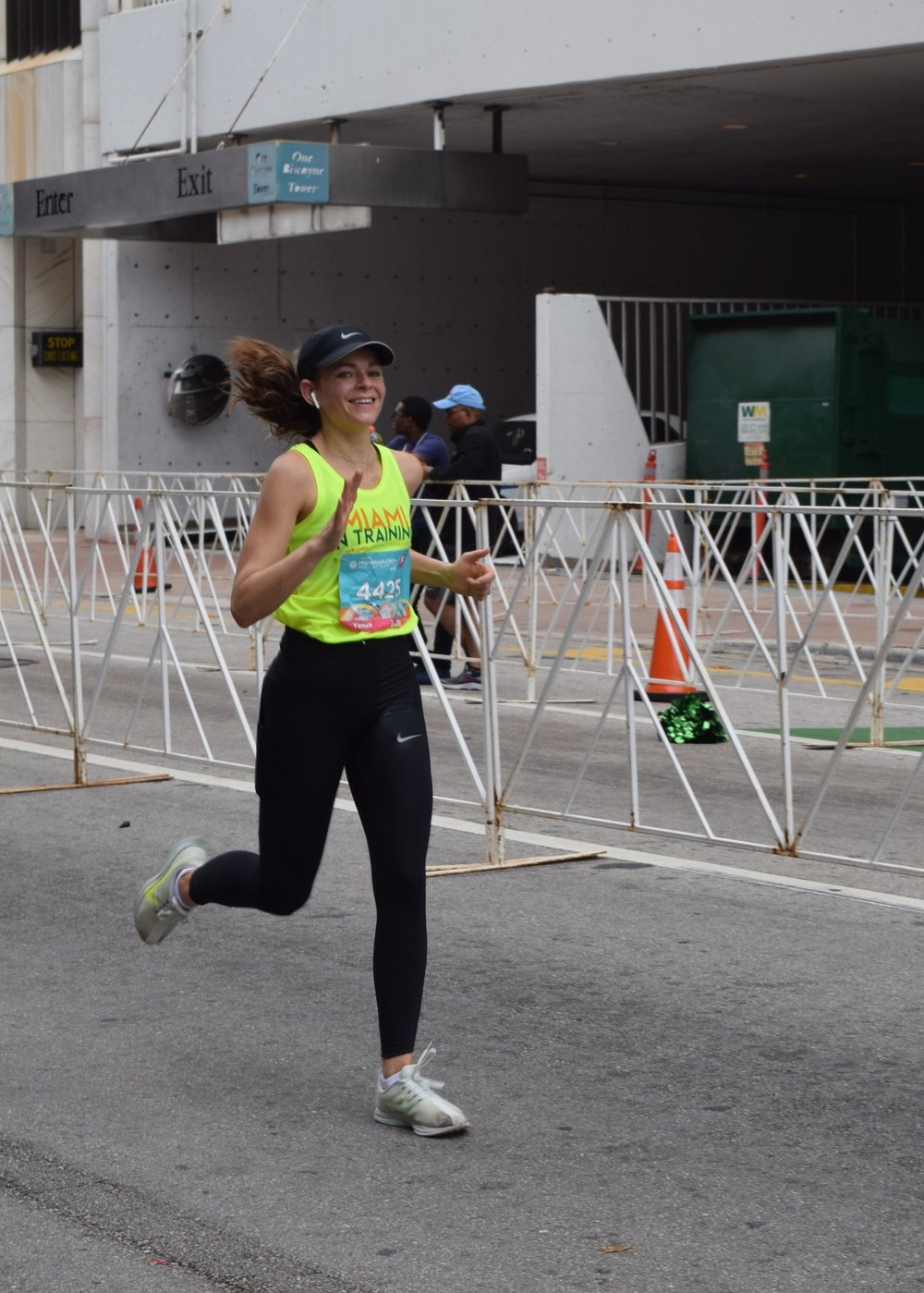 Elly about to cross the finish line at the 2019 Miami Marathon.