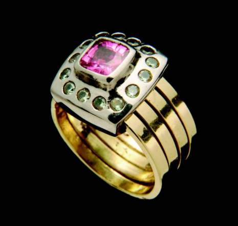 Renaissance ring of a cushion pink sapphire surrounded by grey sapphires