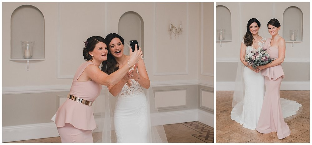 Face-timing a friend who couldn't make it, the bride with her maid of honour.