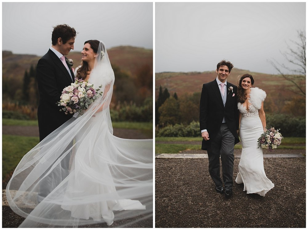 Bride and groom portraits with a long windy veil at Auchen castle in Scotland