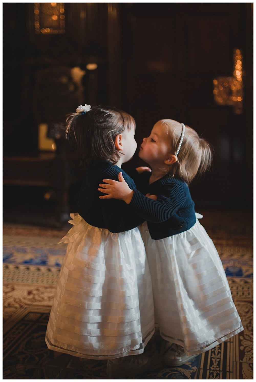 The cutest little flower girls in striped dresses with little cardigans. At Liverpool Town Hall.