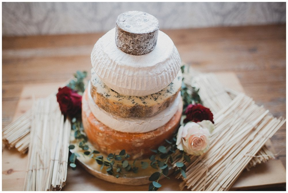 Alternative wedding cake with a differnt round of cheese for each tier.