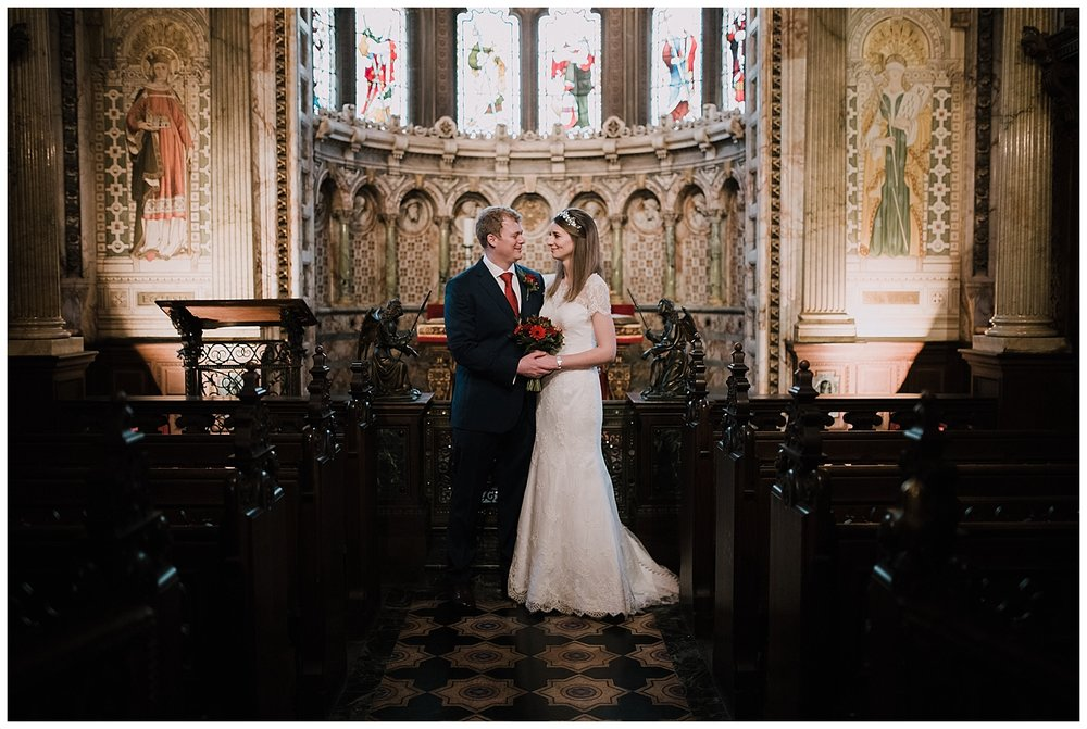 Bride and groom in the little chapel at their Crewe Hall wedding.
