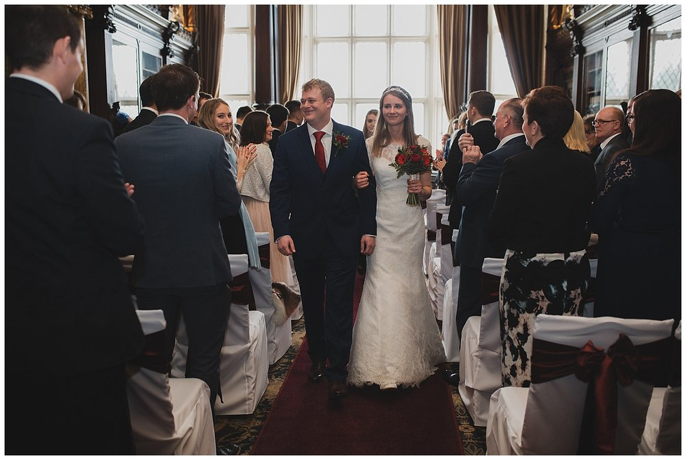 Bride and groom recessional at Crewe hall in cheshire