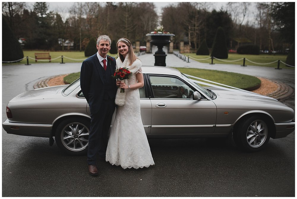Bride and father arrive in a vintage Jag for a Crewe Hall wedding.