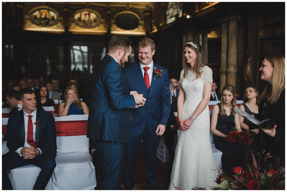 Best man presents the rings at a Crewe Hall wedding.