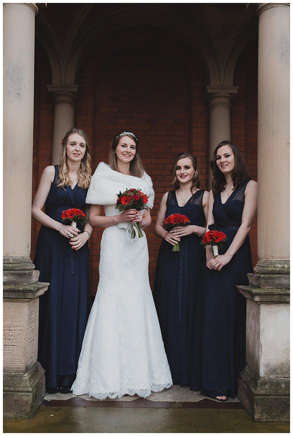 Bridesmaids and bride at a winter wedding at Crewe Hall.
