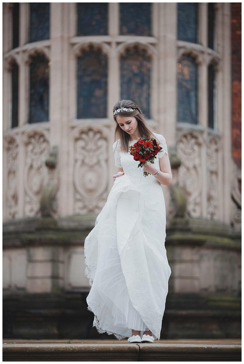 Bride checks her dress at her Cheshire wedding.