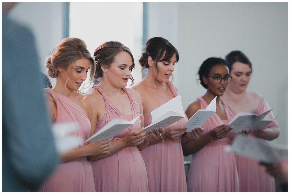 Bridesmaids singing in church at Altrincham Baptist church.
