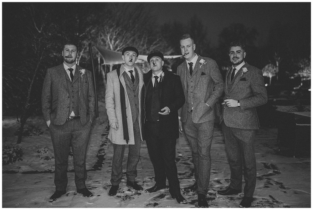 Groom and groomsmen in a Peaky Blinders moment