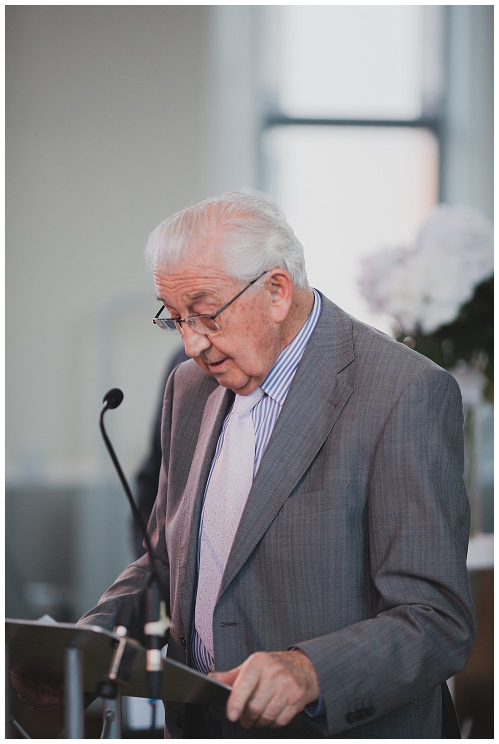 Grandfather reading at church wedding