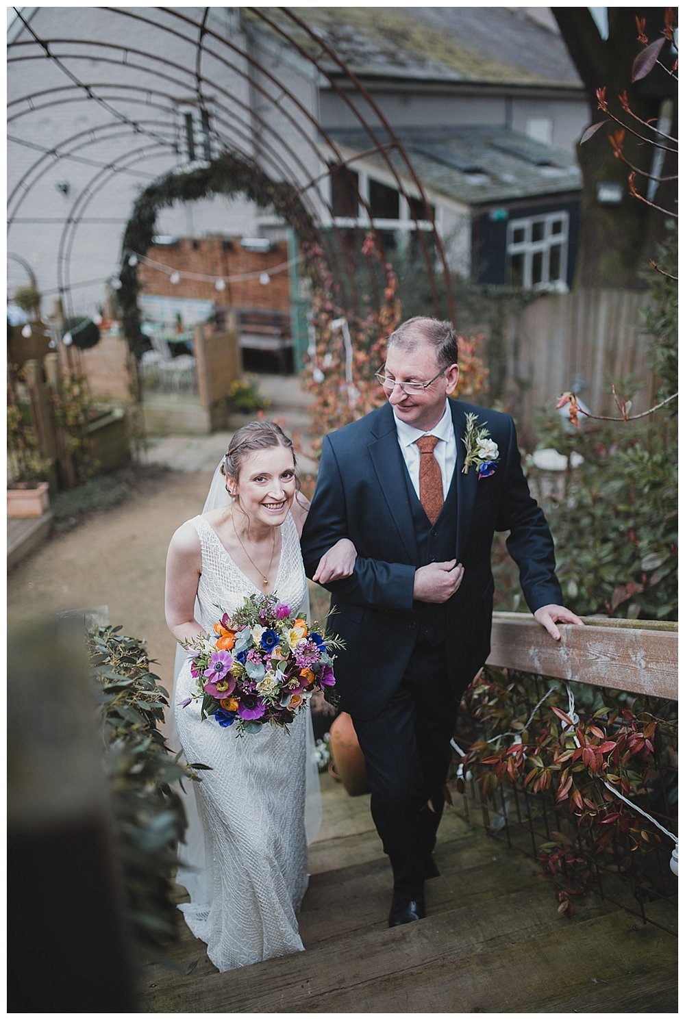 Bride and father arrive for the ceremony. Bright spring bouquet by Living Colours.