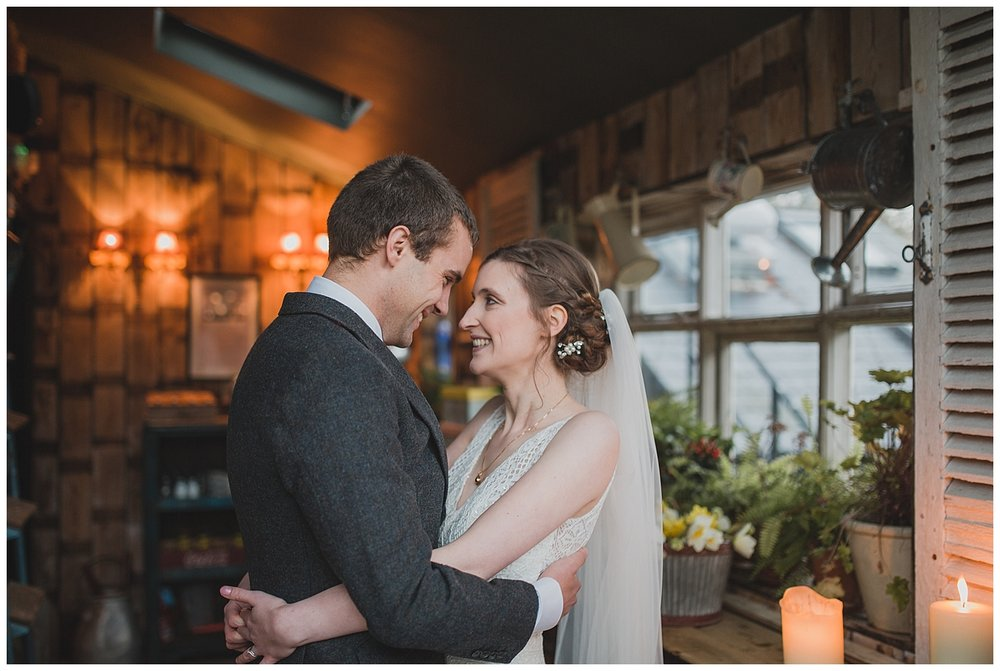 Bride and groom in the potting shed at the Roebuck Inn Mobberley, Cheshire.