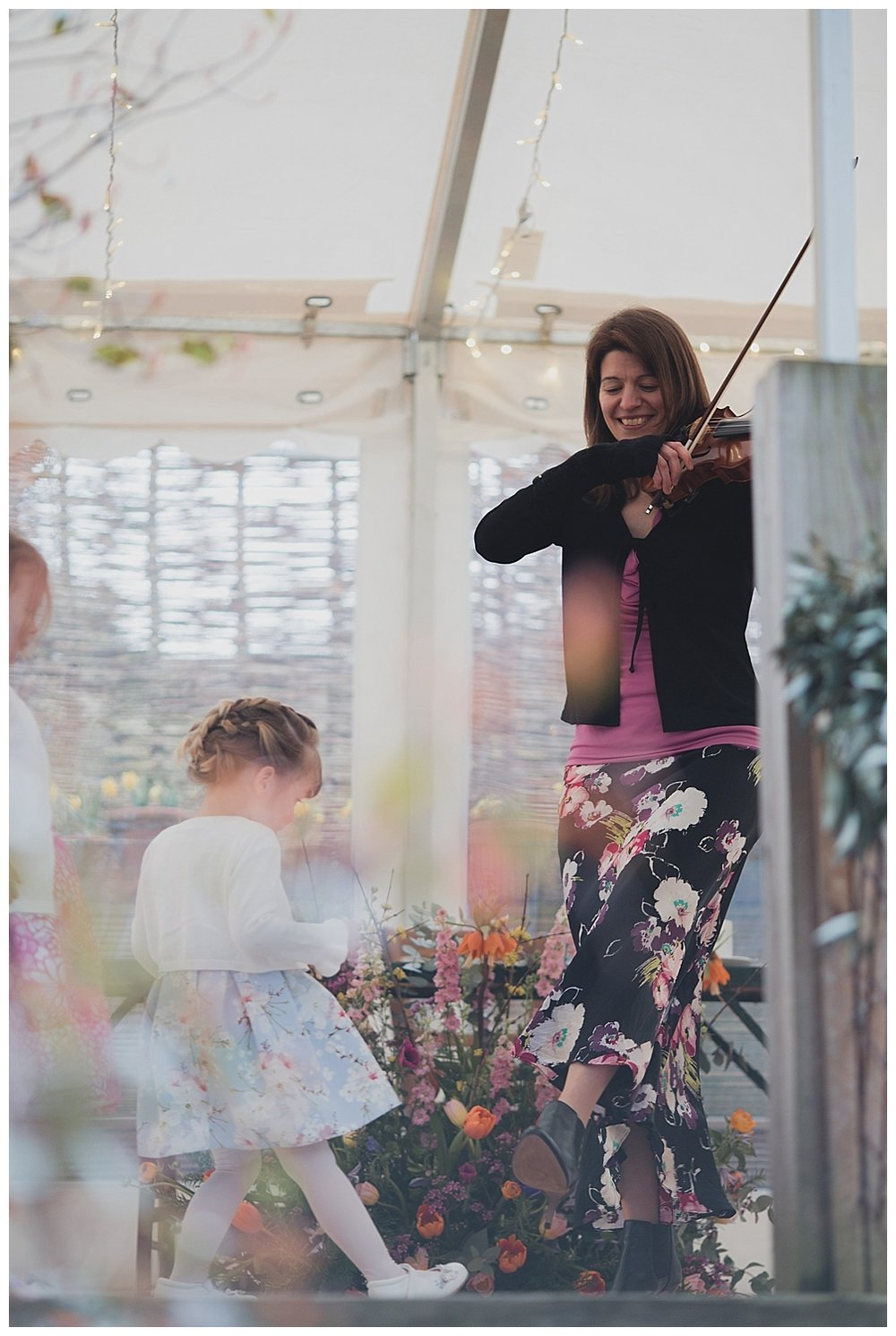 Violinist for wedding ceremonies plays in the marquee at the Roebuck Inn, Mobberley.