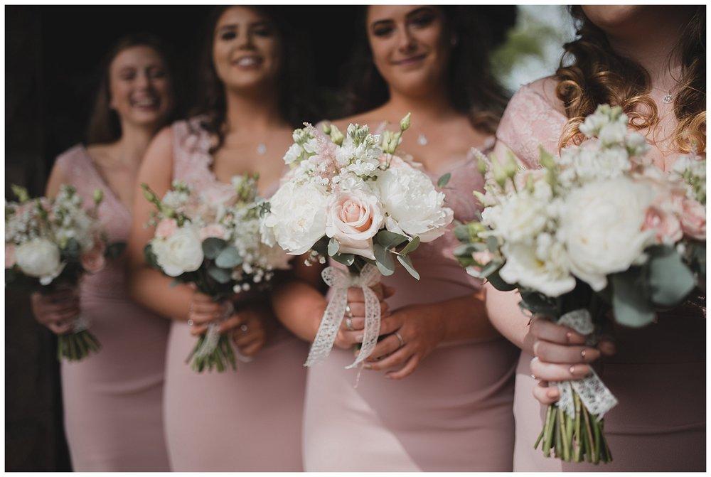 Pastel bridesmaids bouquets buy Blossoms florist.