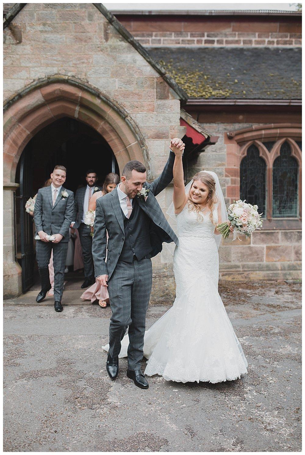 The newlyweds celebrate at St. Luke's Church Endon, Stoke.