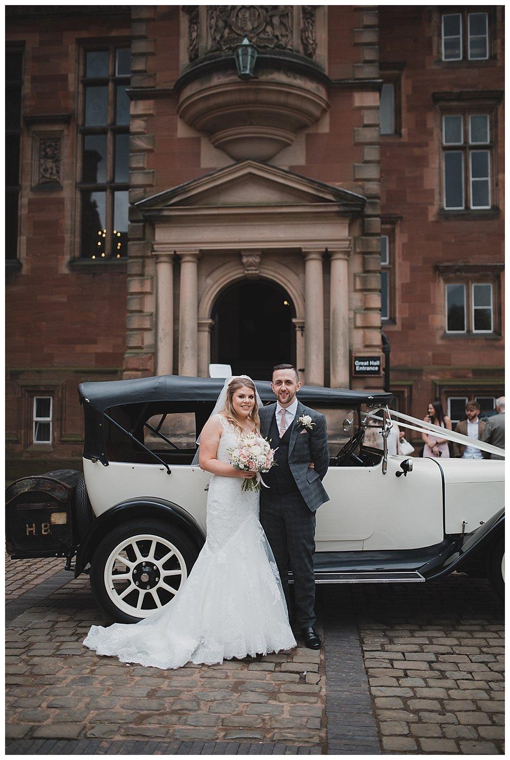 Bride and groom arrive at Keele Hall.