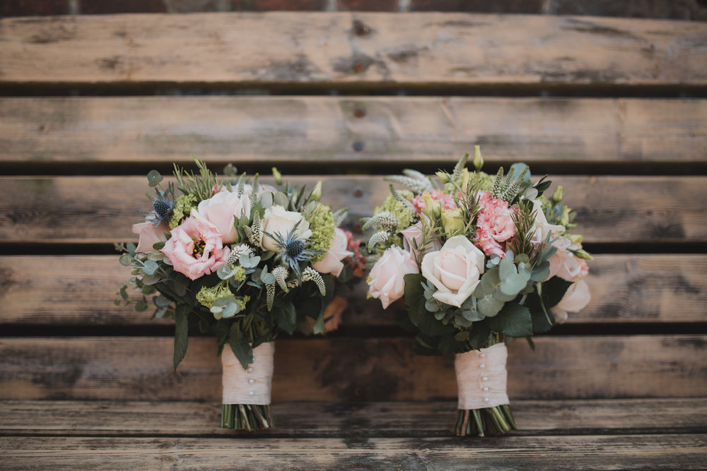 Summer bridal bouquets for two brides.