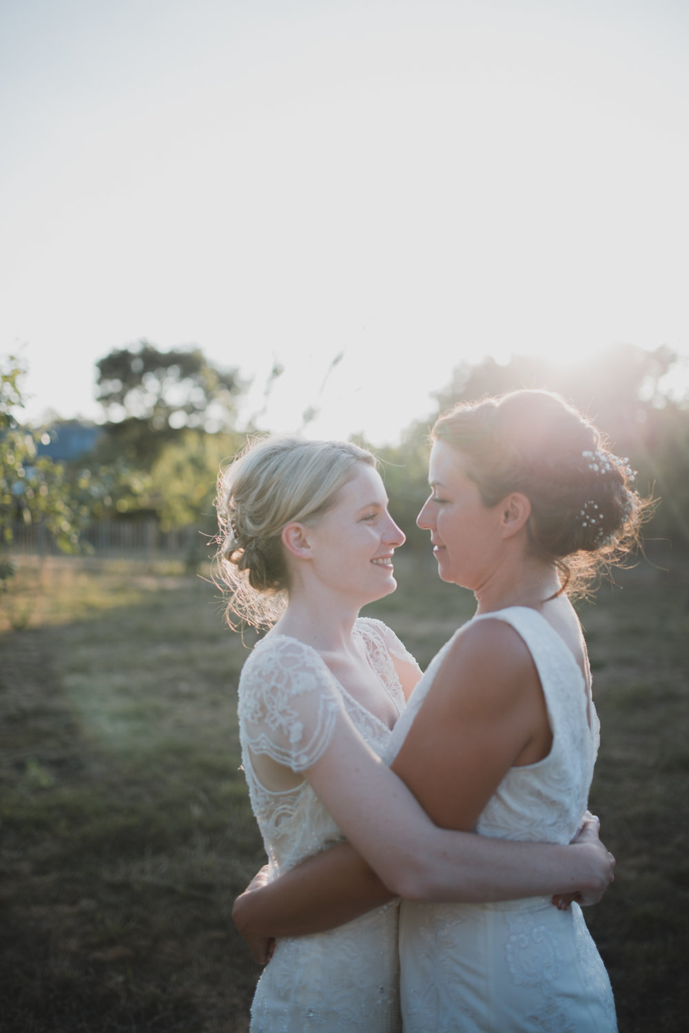 Two brides at couples sunset orchard session