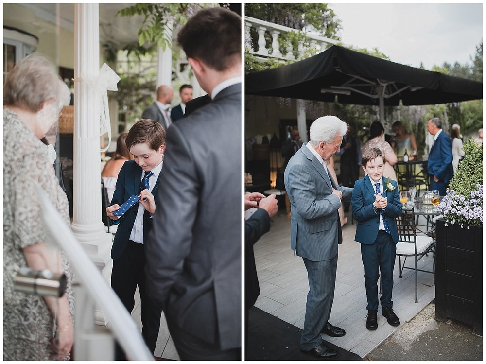 Alex the page boy shows off his dinosaur tie at this Yellow Broom wedding.