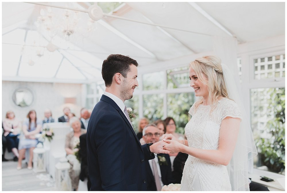 Exchanging rings at this restaurant wedding in Cheshire