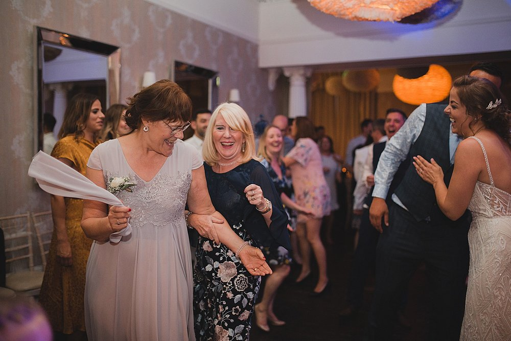 Mothers of the bride and groom hit the dance floor