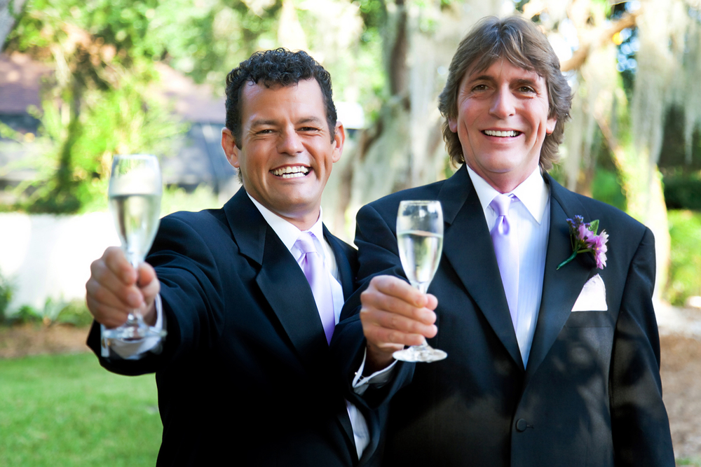 Kansas-city-LGBT-gay-wedding-couple-champagne-toast-optimized).jpg