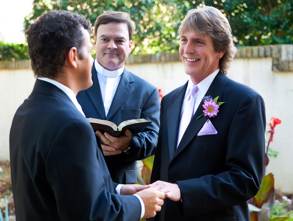 LGBTt-Kansas-City-gay-couple-exchanges-wedding-vows-m (1).jpg