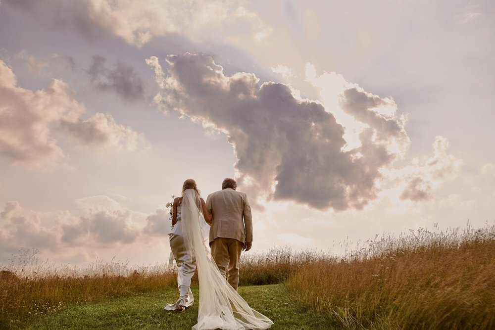 This is one of the most beautiful pictures I have seen. It was taken by the brilliant Matt Blum. www.mattblumphotography.com  I love the imagery of Rachel's father, Olav, escorting her into hew horizons.