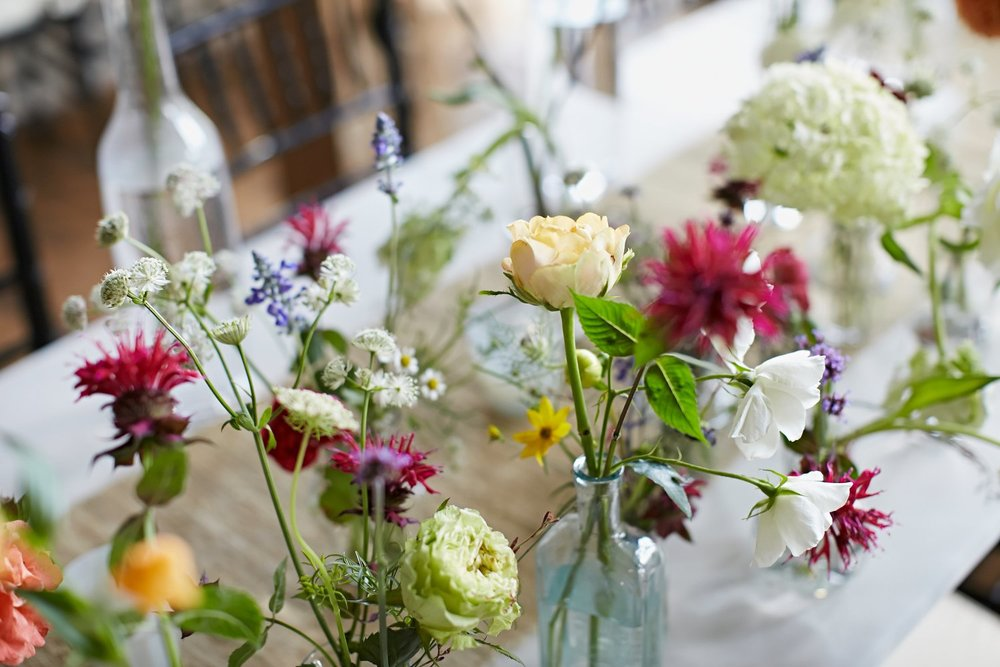The tables were strewn with every kind of bottle and vase you can image. I used wild flowers cut from the property mixed with flowers I purchased at the NY Flower Market. It was a delightful mix of the elegant and the untamed.