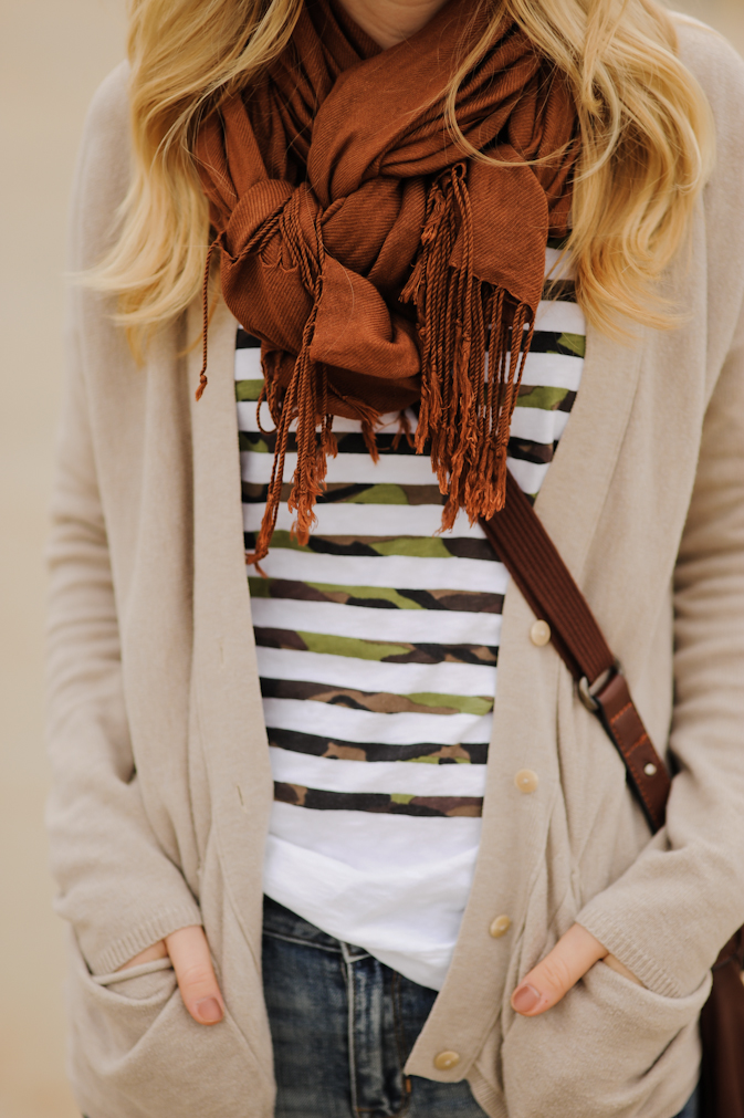 Image via  That's Your Gold   For a fashion forward meets utilitarian vibe, the woven scarf knot is just right for those who want the best of both worlds. This knot keeps the tails close and out of your way, whether grocery shopping or chasing little ones at the park. Best when bundled over a pullover or an open cardigan, this look translates from day to night with a snap of your fingers. Check out this handy  tutorial  from Kayley Anne of That's Your Gold - previously known as Sidewalk Ready - to get the hang of this twisty, curvy knot combo.